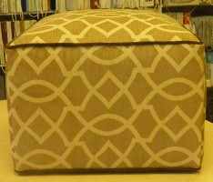Yellow Upholstered Ottoman with Brown Trim