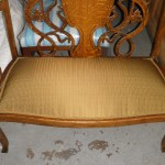 Gold fabric brings out the light-catching qualities in this rebuilt settee
